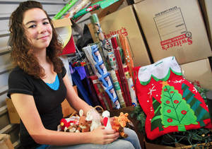 "Photo - Mariah McClellin of Oklahoma City sits in a storage unit that houses donations for ""Stockings for the Homeless,"" a holiday program she founded several years ago. The stockings contain donations such as holiday gifts, such as the Beanie Babies at left, or toiletry items.  Photos By Chris Landsberger, The Oklahoman"