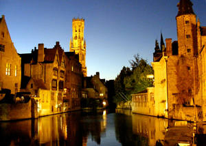 Photo -  Bruges's dreamy canal was essential to its early history as a trading center.  (photo credit: Gretchen Strauch/Rick Steves' Europe)