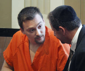photo - Christopher Dunham, convicted of child neglect in a motor home fire that killed his three children, speaks to his attorney as he appears for sentencing before District Judge Jerry Bass at the Oklahoma County Courthouse on Tuesday.  By Paul Hellstern, The Oklahoman <strong>PAUL HELLSTERN - Oklahoman</strong>