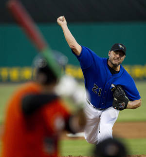 Photo -   Sugar Land Skeeters starter Roger Clemens (21) releases a pitch to Long Island Ducks' Matt Esquivel during the second inning of a minor league baseball game at Constellation Field Friday, Sept. 7, 2012, in Sugar Land, Texas. (AP Photo/Houston Chronicle, Brett Coomer) MANDATORY CREDIT