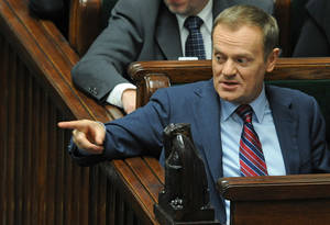 Photo - FILE - In this Wednesday, Dec. 12, 2012 file photo Polish Prime Minister Donald Tusk gestures during the final debate on the Polish budget for 2013, ahead of the voting in the parliament, in Warsaw, Poland. The office of Polish Prime Minister Donald Tusk says he has been hospitalized with an acute infection of the respiratory duct. The office said Thursday Jan. 24, 2013 via Twitter that Tusk will however be temporarily discharged from the hospital on Friday to attend a voting session in Parliament. (AP Photo/Alik Keplicz, File)