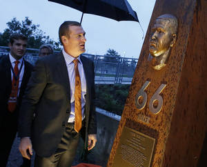 Photo - Former Denver Broncos center Tom Nalen looks at a newly unveiled pillar bearing his likeness at the opening ceremony for the Broncos Ring of Fame Plaza, at Mile High Stadium in Denver, Friday Sept. 27, 2013. Nalen is to be inducted into the Ring of Fame this weekend. (AP Photo/Brennan Linsley)