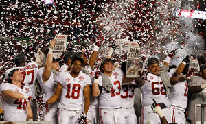 photo - Alabama players celebrate after the BCS National Championship college football game against Notre Dame Monday, Jan. 7, 2013, in Miami. Alabama won 42-14. (AP Photo/Wilfredo Lee)