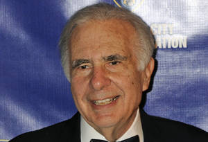 Photo - FILE - In this March 16, 2010 file photo, financier Carl Icahn poses for photos upon arriving for the 32nd annual New York City Police Foundation Gala in New York. Icahn is pressuring Apple to spend $150 billion buying back its own stock, a target that would more than double the amount that the company's board authorized in a previous attempt to placate frustrated shareholders. (AP Photo/Henny Ray Abrams, File)