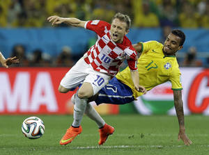 Photo - Croatia's Luka Modric is fouled by Brazil's Luiz Gustavo, right, during the group A World Cup soccer match between Brazil and Croatia, the opening game of the tournament, in the Itaquerao Stadium in Sao Paulo, Brazil, Thursday, June 12, 2014.  (AP Photo/Kirsty Wigglesworth)