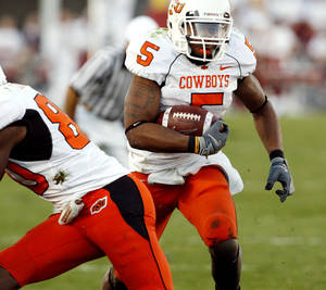 Photo - Former OSU running back Keith Toston will participate in the NFL Combine. PHOTO BY STEVE SISNEY, THE OKLAHOMAN