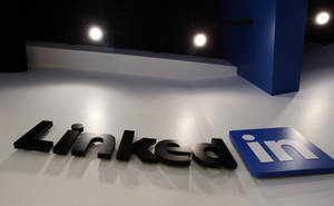 Photo - FILE - In this May 19, 2011 file photo,the LinkedIn logo is displayed in the foyer at headquarters in Mountain View, Calif. LinkedIn Corp. reports quarterly earnings on Thursday, Feb. 6, 2014. (AP Photo/Paul Sakuma, File)