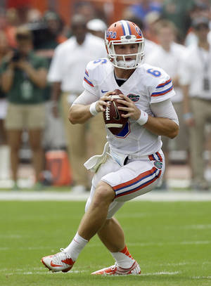 Photo - Florida quarterback Jeff Driskel drops back as he prepares to pass against Miami during the first half of an NCAA football game, Saturday, Sept. 7, 2013, in Miami Gardens, Fla. (AP Photo/Alan Diaz)