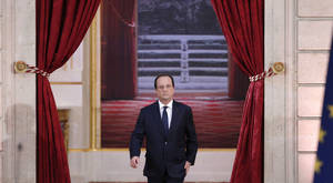 Photo - French President Francois Hollande arrives to deliver his speech at his  annual news conference, Tuesday, Jan.14, 2014 at the Elysee Palace in Paris. The French president's complex personal life ó and what it means to be the first lady in modern society ó may get a full airing as Hollande answers questions for the first time since a tabloid reported he was having an affair with an actress. (AP Photo/Christophe Ena)