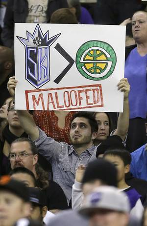 Photo -  In this Jan. 10, 2013, file photo, Sacramento Kings fan Gerald McDaniel displays his feelings toward the Maloof family, owners of the team before an NBA basketball game against the Dallas Mavericks in Sacramento, Calif.  After backing out of the deal to build a new arena in Sacramento and announcing the sale of the Kings to a group that wants to move the team to Seattle, the brothers have become the city's most-reviled villains heading into a preliminary NBA meeting on the issue Wednesday, April 3, 2013, in New York. (AP Photo/Rich Pedroncelli, File)
