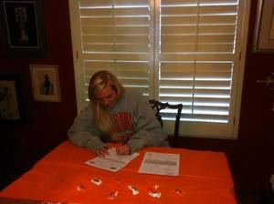 Photo - Bishop McGuinness soccer standout Abbey Akin signed with OSU on Wednesday. PHOTO PROVIDED