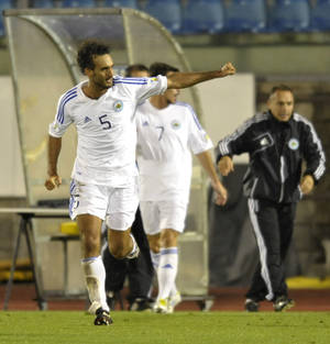 Photo - San Marino's Alessandro Della Valle celebrates after scoring during a World Cup qualifying group H soccer match between Poland and San Marino at the Serravalle stadium in San Marino, Tuesday, Sept. 10, 2013. (AP Photo/Marco Vasini)