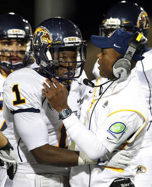 Photo -   Kent State's Dri Archer (1) is congratulated by head coach Darrell Hazell after his interception against Buffalo during the second half of an NCAA college football game in Amherst, N.Y., Wednesday, Sept. 19, 2012. Kent State won 23-7. (AP Photo/Bill Wippert)