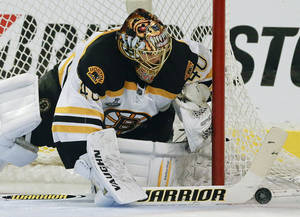 Photo - Boston Bruins goalie Tuukka Rask (40) seals off the goal against the Chicago Blackhawks in the second period during Game 2 of the NHL hockey Stanley Cup Finals, Saturday, June 15, 2013, in Chicago. (AP Photo/Nam Y. Huh)