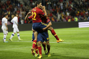 Photo - Spain's Jesus Navas, left, celebrates his goal with teammate Pedro Rodriguez, right, after scoring their second goal during a friendly soccer match between Spain and Chile at the Stade de Geneve stadium, in Geneva, Switzerland, Tuesday, Sept. 10, 2013. (AP Photo/Keystone, Salvatore Di Nolfi)