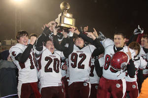 Photo - HIGH SCHOOL FOOTBALL / CELEBRATION: Shattuck players celebrate with the gold ball trophy after beating Tipton in the Class C state championship game on Friday, Dec. 2, 2011. PHOTO BY BRANDON NERIS, THE LAWTON-CONSTITUTION