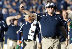 Photo - Notre Dame head coach Brian Kelly directs his team against Air Force in the second quarter of an NCAA college football game in Air Force Academy, Colo., Saturday, Oct. 26, 2013. (AP Photo/David Zalubowski)