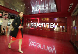 Photo - FILE - In this April 9, 2013 file photo, a customer leaves a J.C. Penney store in New York. J.C. Penney on Wednesday, Jan. 15, 2014 announced it will cut 2,000 jobs and close 33 stores as it tries to get back on the path to profitability. (AP Photo/Mark Lennihan, File)