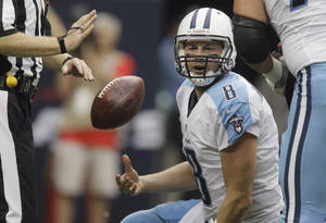 photo -   Tennessee Titans quarterback Matt Hasselbeck (8) tosses the ball to an official after he was sacked in the second quarter of an NFL football game against the Houston Texans Sunday, Sept. 30, 2012, in Houston. (AP Photo/Patric Schneider)