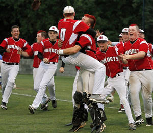 photo - Winning pitcher Hunter Harrison of Hilldale  leaps into the arms of his catcher, Jarrard Poteete  as players rush onto the field from their dugout after the final out for Berryhill during the Class 4A state high school baseball championship game  at Shawnee High School's Memorial Park. on Saturday,,  May 12, 2012.  The Hilldale Hornets defeated the Berryhill Chiefs, 2-1.      Photo by Jim Beckel, The Oklahoman