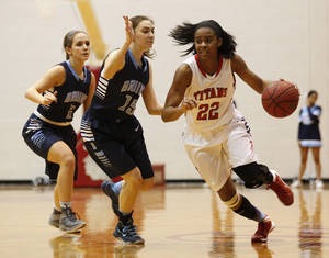 Photo - Carl Alberts's Jordan Gilbert (22) drives the ball past Bartlesville's Julie Benyshek (15) and Gabby Culver (2) during the Carl Albert Classic Tournament in Midwest City, Saturday, Jan. 25, 2014.  Photo by Garett Fisbeck, For The Oklahoman