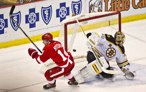 Photo - Detroit Red Wings forward Gustav Nyquist (14) scores the game-winning goal against Boston Bruins goalie Tuukka Rask (40), of Finland, during the third period of an NHL hockey game in Detroit, Mich., Wednesday, April 2, 2014. The Red Wings won 3-2. (AP Photo/Tony Ding)