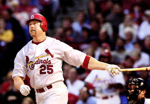 Photo - Was former major league slugger Mark McGwire's confession about steroids use during his career heart-felt, or was it self-serving because of his job as hitting coach with St. Louis? AP PHOTO
