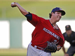 Photo - MINOR LEAGUE BASEBALL: Asher Wojciechowski of the Oklahoma City RedHawks pitches against the Nashville Sounds during their baseball game at the Chickasaw Bricktown Ballpark in Oklahoma City, Wednesday, August 28, 2013. Photo by Bryan Terry, The Oklahoman