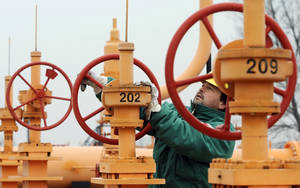 Photo -  An engineer of the FGSZ Ltd, Hungary's natural gas transporting company, checks the pressure in the pipelines forwarding natural gas from underground storage facilities for the country's capital at a gas receiving station in Vecses, Hungary, near Budapest.  AP File Photo  <strong>Bela Szandelszky -  AP </strong>