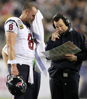 Photo - Houston Texans quarterback Matt Schaub (8) and head coach Gary Kubiak talk during the second quarter of an NFL football game against the New England Patriots in Foxborough, Mass., Monday, Dec. 10, 2012. (AP Photo/Steven Senne)