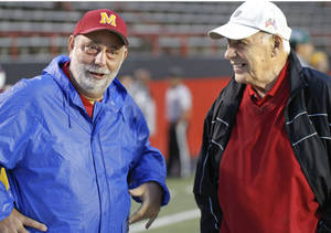 Photo - Don Bucci, right, is currently Cardinal Moody's athletic director. Photo Courtesy Youngstown Vindicator