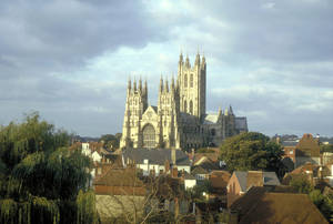 Photo - his undated image provided by Visit Britain shows Canterbury Cathedral looming over the rooftops and buildings of Canterbury, England. The ancient cathedral, where Archbishop Thomas Becket was martyred in 1107, remains a major pilgrimage site and tourist attraction, visited by a million people a year. (AP Photo/Visit Britain)