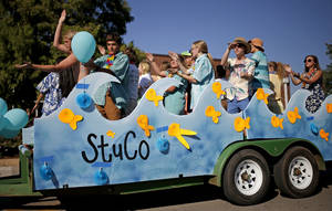 Photo - Members of the student council ride in their float during the  Edmond Memorial High School homecoming parade in downtown Edmond. PHOTO BY BRYAN TERRY, THE OKLAHOMAN. <strong>Bryan Terry - THE OKLAHOMAN</strong>