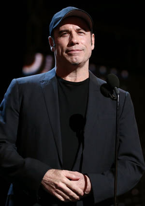 Photo - Actor John Travolta attends rehearsals for the 85th Academy Awards in Los Angeles, Saturday, Feb. 23, 2013. The Academy Awards are scheduled for Sunday, Feb. 24, 2013. (Photo by Matt Sayles/Invision/AP)