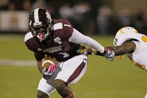 Photo -   Mississippi State wide receiver Chad Bumphis (1) fights off an attempted tackle by Tennessee defensive back Justin Coleman after a short pass reception in their NCAA college football game in Starkville, Miss., Saturday, Oct. 13, 2012. (AP Photo/Rogelio V. Solis)