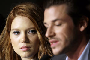 Photo - Actress Lea Seydoux, left, listens to actor Gaspard Ulliel speak during a press conference for Saint-Laurent at the 67th international film festival, Cannes, southern France, Saturday, May 17, 2014. (AP Photo/Thibault Camus)