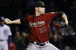 Photo -   Houston Astros starting pitcher Bud Norris delivers during the first inning of a baseball game against the Chicago Cubs, Tuesday, Oct. 2, 2012, in Chicago. (AP Photo/Charles Rex Arbogast)