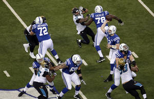 Photo - Indianapolis Colts' Andrew Luck (12) throws during the first half of an NFL football game against the Jacksonville Jaguars Sunday, Dec. 29, 2013, in Indianapolis. (AP Photo/AJ Mast)