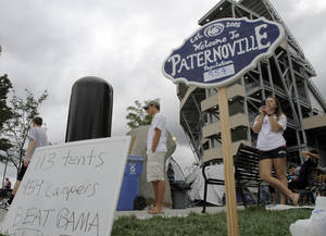 "Photo -   FILE - In this Sept. 9, 2011, file photo, Penn State students mill around a tent city they call ""Paternoville,"" named after the head football coach Joe Paterno, outside Beaver Stadium in State College, Pa. Paternoville is history. It will be replaced by Nittanyville. (AP Photo/Keith Srakocic, File)"