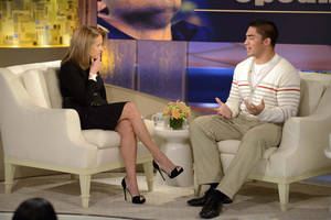 "photo - This Jan. 22, 2013 photo released by ABC Notre Dame linebacker Manti Te'o, right, speaking with host Katie Couric during an interview for ""Katie,"" in New York. Te'o has told Katie Couric that he briefly lied about his online girlfriend after discovering she didn't exist, while maintaining that he had no part in creating the hoax. Pressed by Couric to admit that he was in on the deception, Te'o said he believed that his girlfriend Lennay Kekua had died of cancer and didn't lie about it until December. The interview will air on Thursday, Jan. 24.  (AP Photo/Disney-ABC, Lorenzo Bevilaqua)"