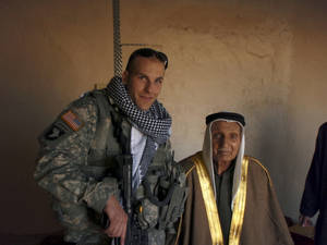 Photo - 1st Lt. Michael Behenna with a local Iraq leader on one of his missions. Photo provided by the Behenna Family
