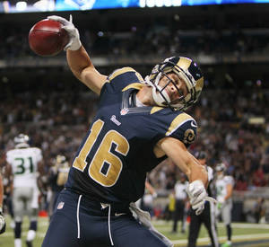 Photo -   Rams wide receiver Danny Amendola spikes the ball after scoring on a fake field goal attempt in second quarter action during a game between the St. Louis Rams and the Seattle Seahawks on Sunday, September 30, 2012 at the Edward Jones Dome in St. Louis. (AP Photo/St. Louis Post-Dispatch, Chris Lee ) EDWARDSVILLE INTELLIGENCER OUT; THE ALTON TELEGRAPH OUT
