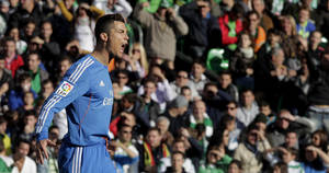 Photo - Real Madrid's Cristiano Ronaldo reacts after scoring against Betis during their La Liga soccer match at the Benito Villamarin stadium, in Seville, Spain on Saturday, Jan. 18, 2014. (AP Photo/Angel Fernandez)