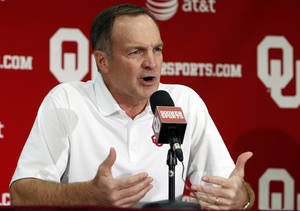 Photo - Head coach Lon Kruger speaks with the media as the University of Oklahoma Sooners (OU) men's basketball team holds its media day at The Lloyd Noble Center on Monday, Oct. 28, 2013  in Norman, Okla. Photo by Steve Sisney, The Oklahoman