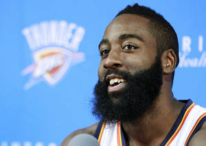 photo -   Oklahoma City Thunder's James Harden smiles as he answers a question during their NBA basketball media day in Oklahoma City, Monday, Oct. 1, 2012. The Sixth Man of the Year is holding out hope that he'll reach terms on a contract extension with the Thunder by the end of the month. (AP Photo/Sue Ogrocki)