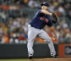 Photo - Cleveland Indians pitcher Scott Kazmir delivers against the Baltimore Orioles in the third inning of a baseball game Wednesday, June 26, 2013 in Baltimore. (AP Photo/Gail Burton)