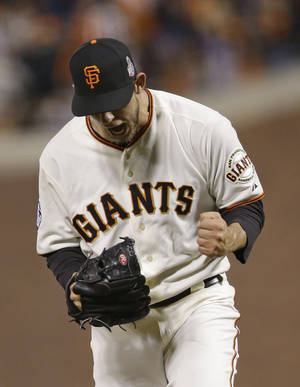 Photo -   San Francisco Giants' Madison Bumgarner reacts after striking out Detroit Tigers' Omar Infante during the sixth inning of Game 2 of baseball's World Series Thursday, Oct. 25, 2012, in San Francisco. (AP Photo/Marcio Jose Sanchez)