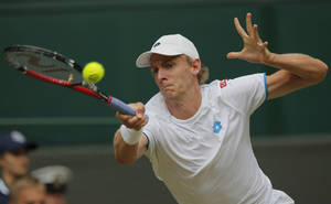 Photo - Kevin Anderson of South Africa plays a return to Andy Murray of Britain during their men's singles match at the All England Lawn Tennis Championships in Wimbledon, London, Monday, June 30, 2014. (AP Photo/Pavel Golovkin)