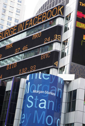 photo - A financial news stock ticker at Morgan Stanley headquarters carries a headline about Facebook Wednesday in New York.   AP Photo