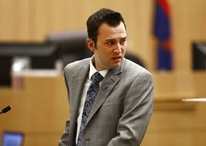 "Photo - Steven Alexander, brother of murder victim Travis Alexander, looks back towards Jodi Arias as he reads his ""victim impact statement"" to the jury on Thursday, May 16, 2013 during the penalty phase of the Jodi Arias trial at Maricopa County Superior Court in Phoenix.  Jodi Arias was convicted of first-degree murder in the stabbing and shooting to death of Travis Alexander, 30, in his suburban Phoenix home in June 2008. (AP Photo/The Arizona Republic, Rob Schumacher, Pool)"